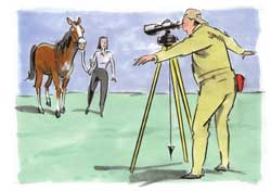 Picture of man looking at horse through a scope